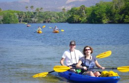 Visitors enjoy kayaking on Manialtepec Lagoon, near Puerto Escondido.
