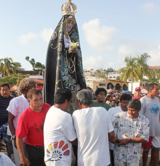 virgen de la soledad carried down the beach